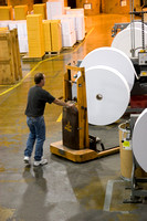 Moving large rolls of paper to convert to envelopes